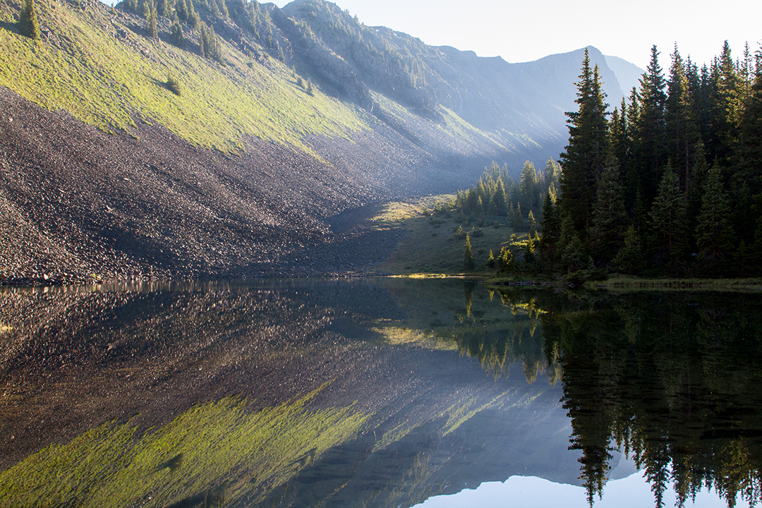 Landscape photograph of a sunrise at a small pond in the Weminuche Wilderness Colorado