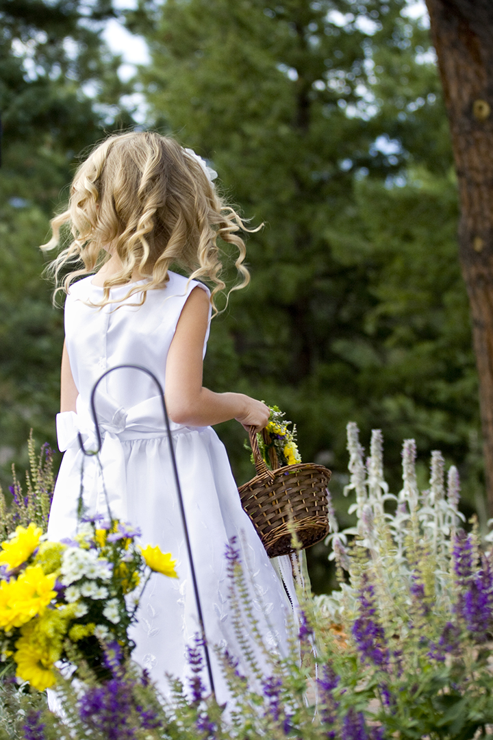 Wedding photograph of flower girl near Evergreen Colorado