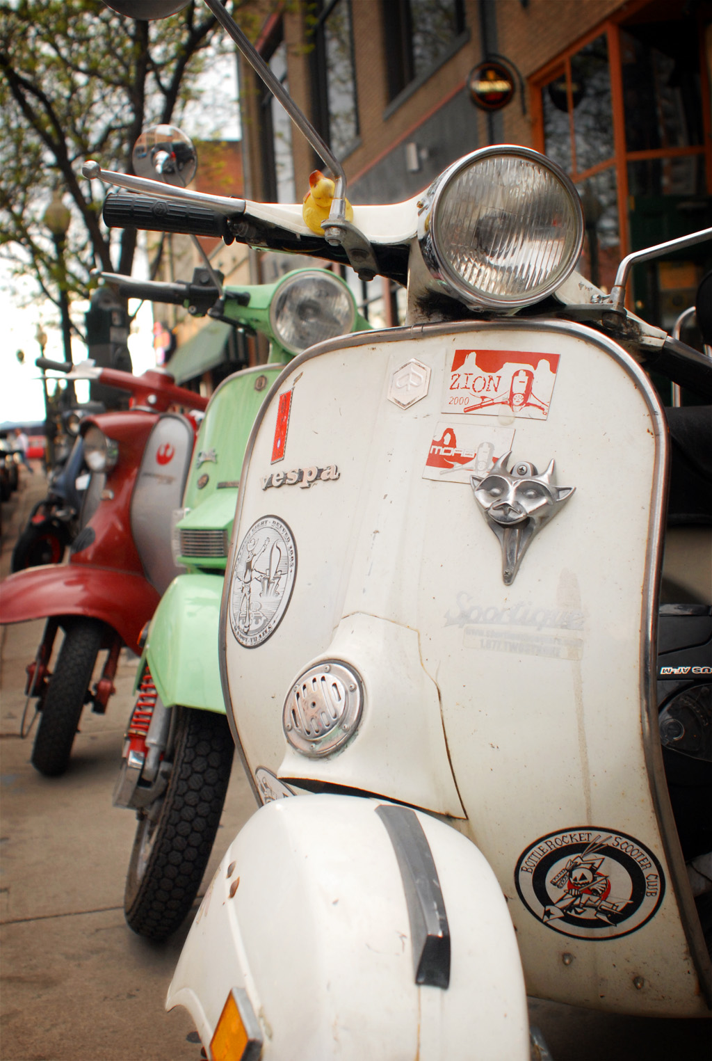 Photograph of Vespas parked off of the street downtown Denver Colorado