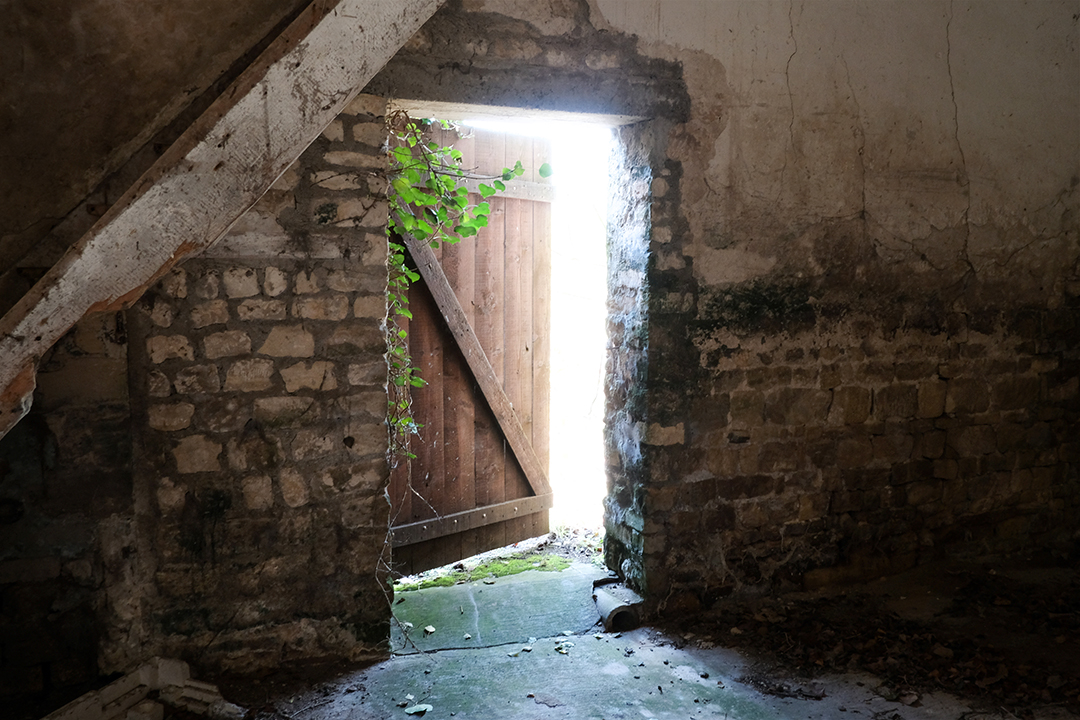 Photograph from inside of an abandoned farm near Omaha Beach in Normandy France